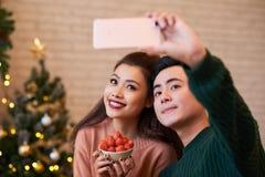 Couple taking selfie Stock Image