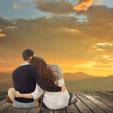 Asian young couple sit and hug together Stock Photography