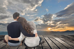 Asian young couple sit and hug together Royalty Free Stock Images