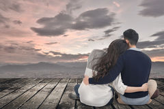 Asian young couple sit and hug together Stock Photos