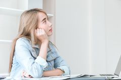 Asian young employee thinking in office. Asian young employee thinking or inattentive imagination dream while working in the office Stock Image