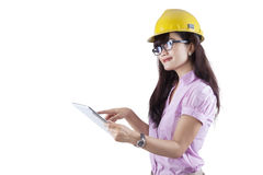 Asian young engineer using digital tablet Royalty Free Stock Photo