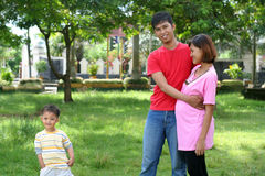 Asian young family. Happy family with pregnant mother stock image