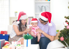 Asian young family celebrating christmas Royalty Free Stock Photo