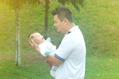 Asian young family. Happy asian father and son spending time outdoor on a summer day royalty free stock images