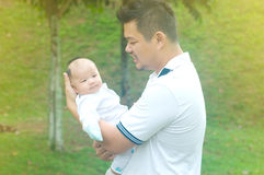 Asian young family. Happy asian father and son spending time outdoor on a summer day stock photo