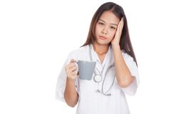Asian young female doctor got headache Stock Photography