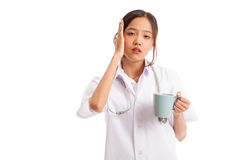Asian young female doctor got headache Stock Photo