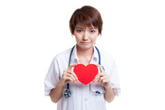 Asian young female doctor hold a red heart. Asian young female doctor hold a red heart isolated on white background stock photography