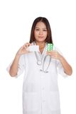 Asian young female doctor show a blank card with medicine Stock Photo