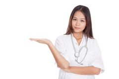 Asian young female doctor show something on her hand Stock Photography