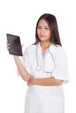 Asian young female doctor show tablet pc Stock Photos