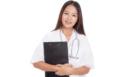 Asian young female doctor smile with a clipboard Royalty Free Stock Images