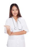 Asian young female doctor smile show her hand Royalty Free Stock Images