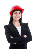 Asian young female wearing red hard hat. Isolated on white. Royalty Free Stock Photos