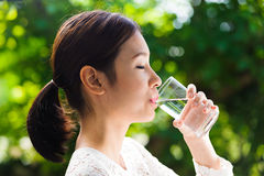 Asian young girl drink water Royalty Free Stock Image