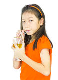 Asian young girl drinks orange juice Stock Images