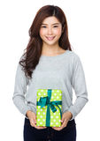 Asian young girl holding large gift box Royalty Free Stock Images