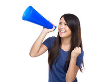 Asian young girl holding megaphone Royalty Free Stock Image