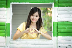 Asian young girl make heart symbol with her hands Stock Photography