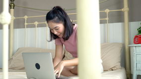 Asian Young girl playing laptop computer stock video footage