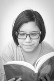 Asian young girl reading book in black and white filter photo Royalty Free Stock Photos
