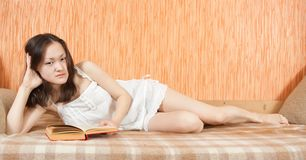 Asian young  girl resting on sofa Stock Photography
