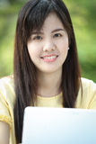 Asian young girl use laptop for search information Royalty Free Stock Photo