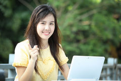 Asian young girl use laptop for search information Royalty Free Stock Photography