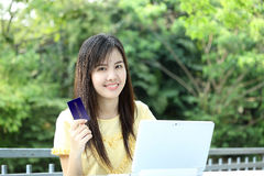 Asian young girl use laptop for Shopping online Royalty Free Stock Images