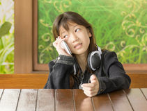 Asian young girl using mobile phone Stock Photo