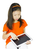 Asian Young girl is using tablet Royalty Free Stock Images