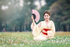Asian young girl kimono. Asian young girl wearing a kimono in natural green grass Stock Photos