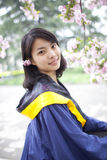 Asian young graduate working in the campus Royalty Free Stock Photo
