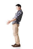 Asian young guy carry or take something Royalty Free Stock Photo
