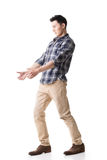 Asian young guy carry or take something Stock Photography