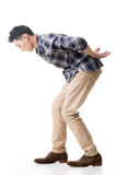 Asian young guy carry or take something Royalty Free Stock Photography
