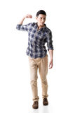 Asian young guy carry or take something. Full length model isolated on white stock photography