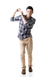Asian young guy carry or take something Royalty Free Stock Image