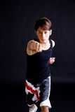 Asian young guy give a punch. Active young asian man doing a punch pose Stock Photos