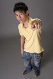 Asian young guy point at you Royalty Free Stock Photography