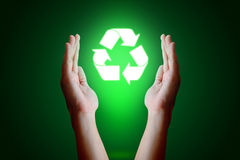 Asian young hand holding recycle  icon and green background. Royalty Free Stock Photo