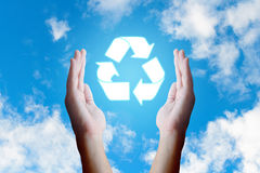 Asian young hand holding recycle  icon and nature clouds and sky Royalty Free Stock Photography