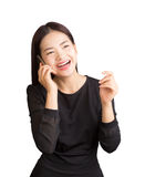 Asian young happy laughing woman talking on her cellphone, white Royalty Free Stock Images