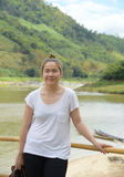 Asian young lady with river in background,casual dress. Asian young lady with river in background,casual dress,travel concept Stock Photos