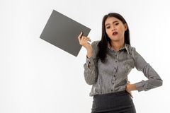 Asian young lady stood with one arm akimbo, holding document file folder. Portrait of beautiful asian young lady stood with one arm akimbo and other holding royalty free stock photo