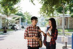 Asian young male and female student outdoor royalty free stock photos