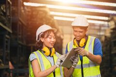 Free Asian Young Man And Women Worker Team Engineer Working Help Support Together Using Tablet Happy Smile To Work In Factory Industry Royalty Free Stock Photos - 216171158