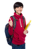 Asian young man with backpack and clipboard Stock Photography