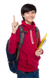 Asian young man with backpack and finger up Royalty Free Stock Photography